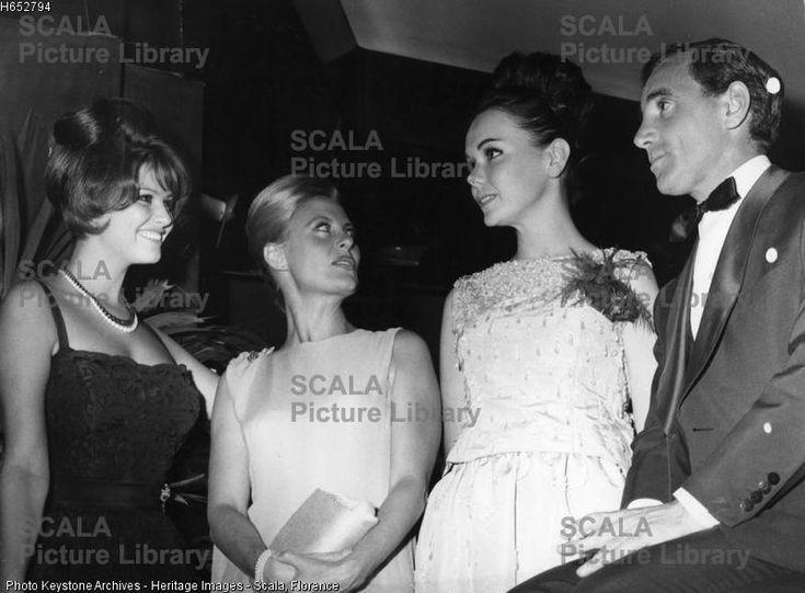 ******** Claudia Cardinale, Michele Morgan, Myriam Schenck and Charles Aznavour, Paris, France, 1961. Cardinale (1938-), Morgan (1920-), Schenck and Aznavour (1924-) at a gala for the film 'Les lions sont lâchés'.