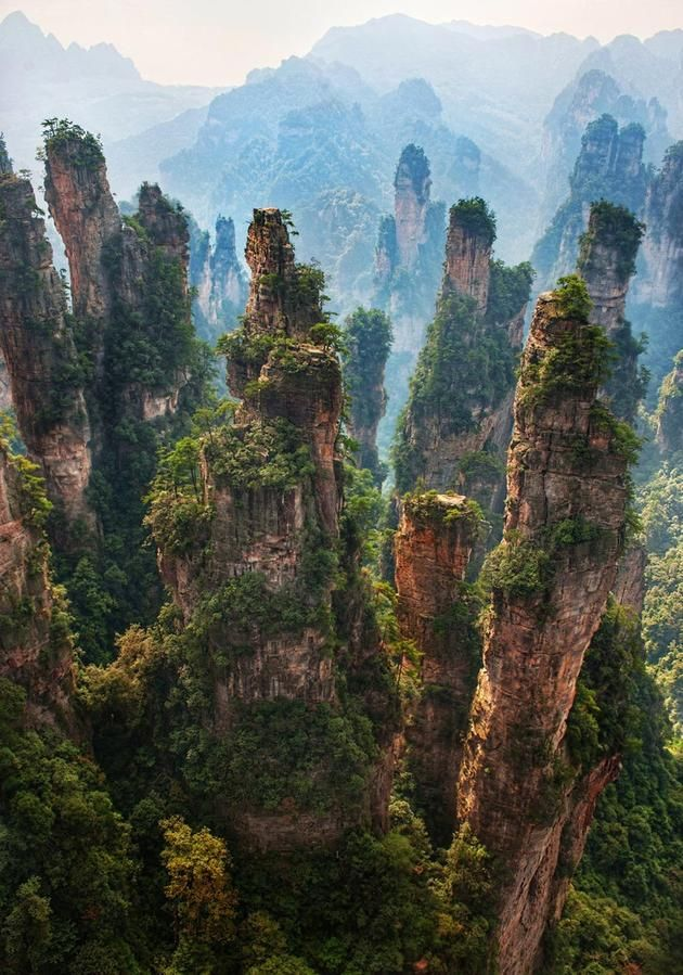 Zhangjiajie National Forest Park  This is where James Cameron drew his inspiration from when he was working on Avatar. Wulingyuan Scenic and Historic Interest Area is located in The Wulingyuan District of the City of Dayong, Hunan Province of China and is known for its stone pillars that reach over 1km in height and resemble the ones seen on Pandora (In the movie Avatar).