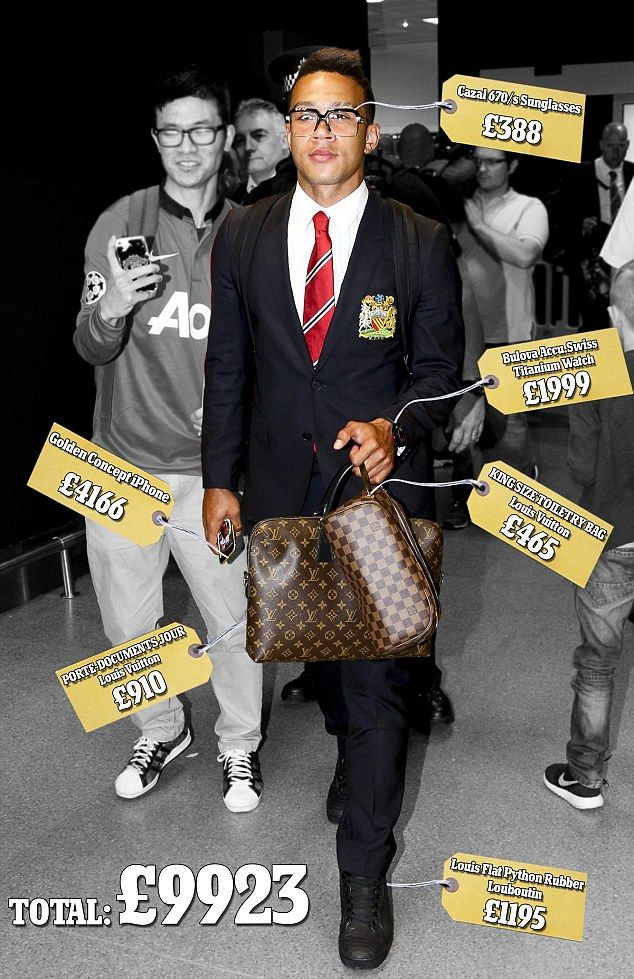 Manchester United's new signing Memphis Depay shows off an expensive set of clothes and ac...