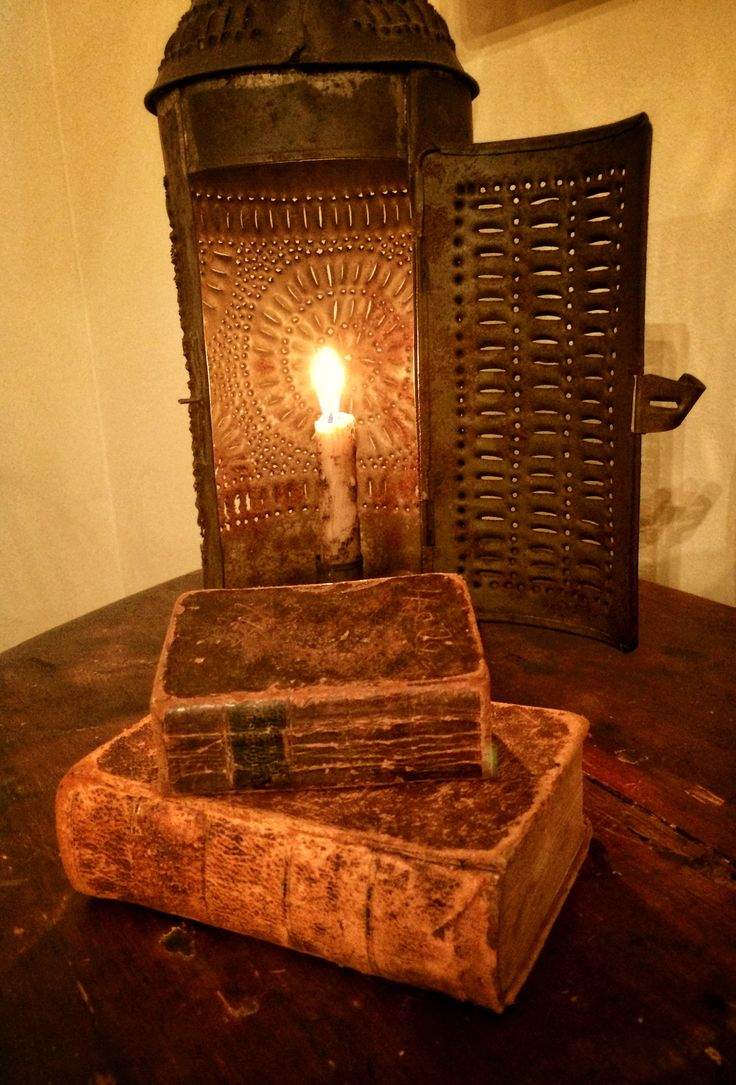 Early tin lantern with early leather books.
