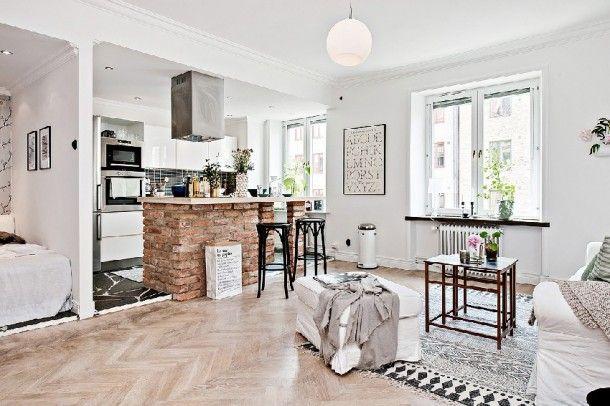 Fundamenta – Otthonok és megoldások Szingliknek való kicsi, modern, hófehér lakás bontott téglával megspékelve - Fundamenta - Otthonok és megoldások