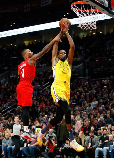 the best attitude fc60f d9cfd Kevin Durant of the Golden State Warriors dunks against Damian Lillard of the  Portland Trail Blazers at Moda Center on December 29 2018 in Portland.
