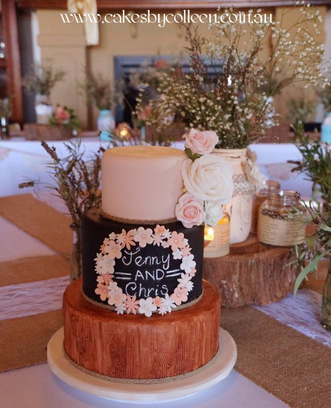 3 Tier rustic themed wedding cake with wood grain finish & chalk effect.