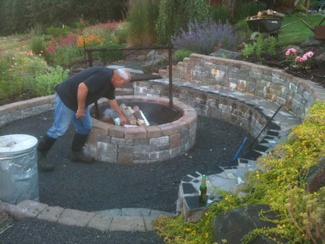 great idea! fire pit area built into hillside, retaining wall=seating area