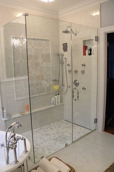 Heavy Frameless Shower. Puts Niche on shower head wall. Also like the ledge; just enough for shaving legs.  Nice.