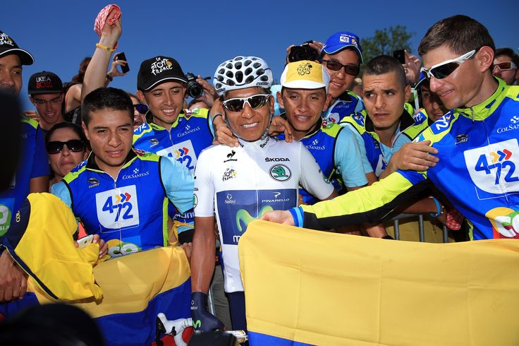 ANNECY, FRANCE - JULY 20: Best young rider Nairo Quintana of Colombia and Movistar Team poses with Colombian cycling fans ahead of stage twenty of the 2013 Tour de France, a 125KM road stage from Annecy to Annecy-Semnoz, on July 20, 2013 in Annecy, France. (Photo by Doug Pensinger/Getty Images)
