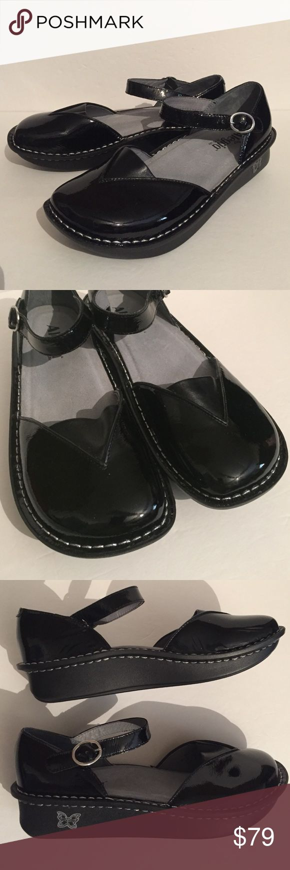 Beautiful Alegria black patent leather shoes!! This is a pair of black Alegria patent leather maryjane shoes. These are very comfortable and have a triangle of soft leather across the top of the shoe for comfort. They also have leather interior lining. They were tried on once and are in excellent condition. Sz 11 (41). Alegria Shoes Flats & Loafers