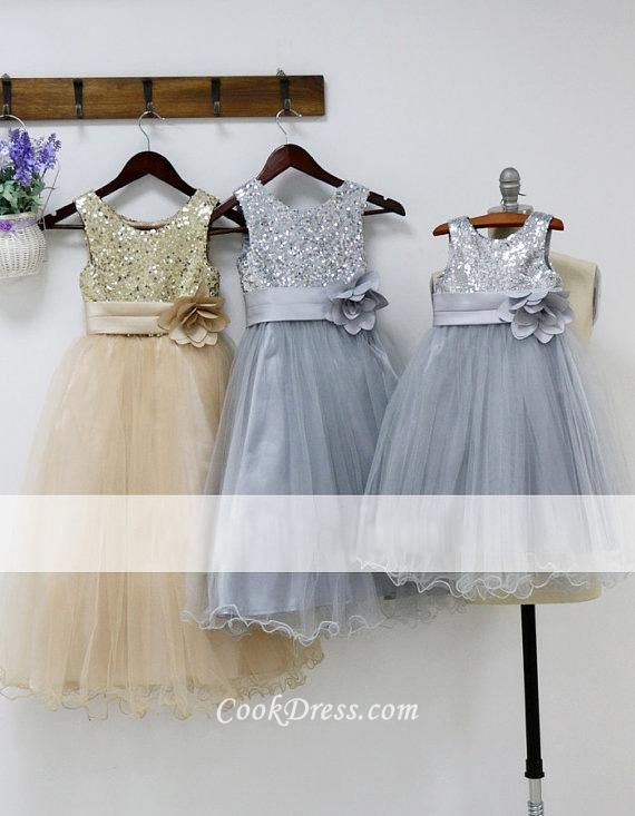 Sparkly designer flower girl dresses,  bling sleeveless bodice is adorned with 3D flower on ribbon at side waist. Full length  tulle skirt overlay zip back. Available grey color, gold color and other customized color.