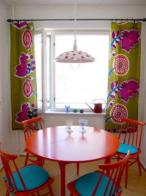 bright curtains, painted furniture, polka dot pendant, love the brightness...