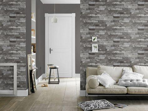 Con papeles pintados de ladrillo puedes conseguir salones minimalistas a la vez de modernos y cálidos.