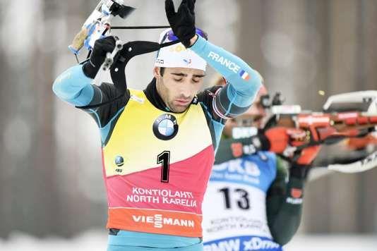 """Biathlon : revenu de loin Martin Fourcade séchappe au classement de la Coupe du monde - Pour sa course de reprise après les JO le quintuple champion olympique a terminé second de la mass start en Finlande. - http://ift.tt/2Hnz2wi - \""""lemonde a la une\"""" ifttt le monde.fr - actualités  - March 11 2018 at 04:28AM"""