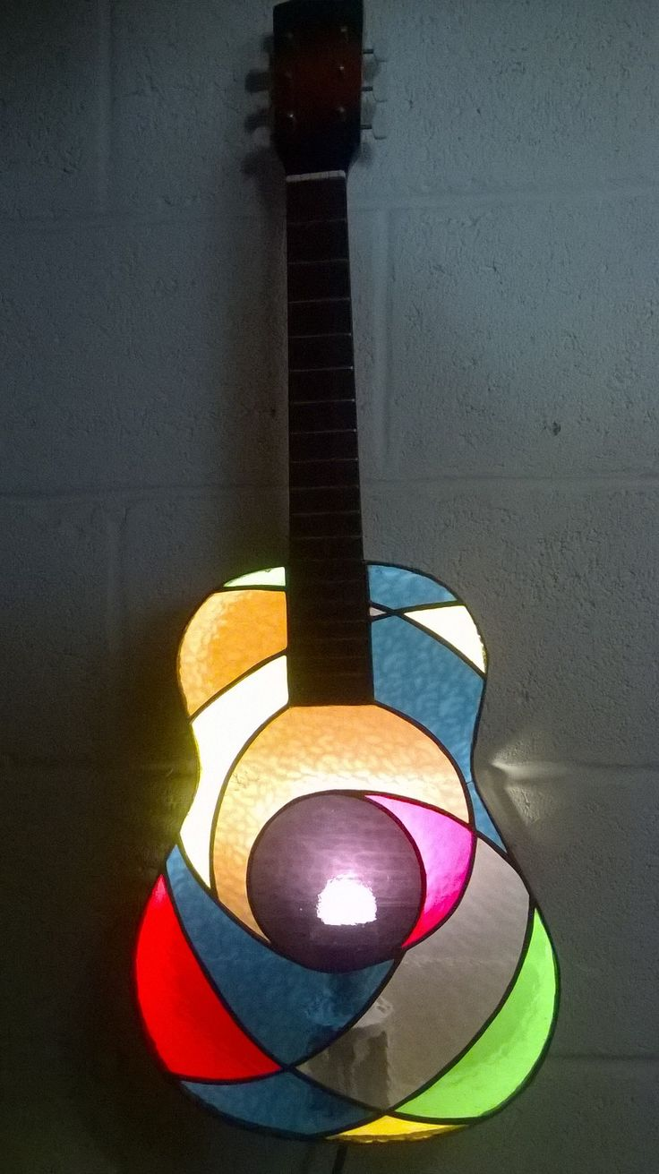 Stained glass guitar lamp.