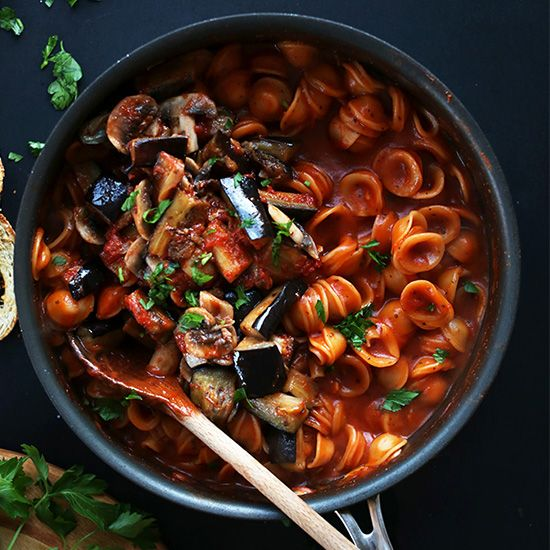 Easy, healthy, one pot vegan pasta in red sauce topped with sauteed mushrooms and eggplant. Customizable, simple and delicious.