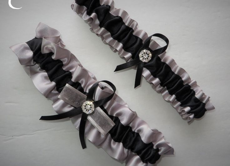 Beautiful Keepsake garter as well as a Toss-away garter in Silver and Black Satin accented with a sparkling rhinestone brooch. These garters are made from quality fabric and ribbons. Relaxed these gar