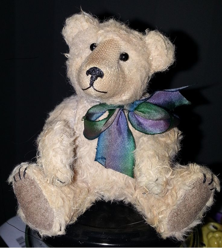 May 2015 - mohair bear 5 inches tall, with glass bead eyes and silk bow.  Paw pads are in fine leather.