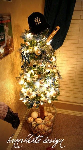 Baseball themed Christmas tree with hat topper & basket of baseballs for base... Cannot wait to decorate Christian's apartment like this.
