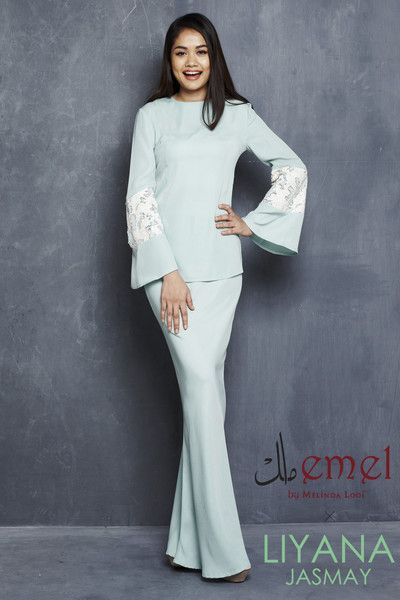 EMEL X LIYANA JASMAY - LILY - MODERN KURUNG WITH SEQUIN BELL SLEEVE (TURQUOISE)  This soft and sweet modern baju kurung is the perfect pastel piece for Raya. It features the textured matte sequin on the sleeves for an added glamour
