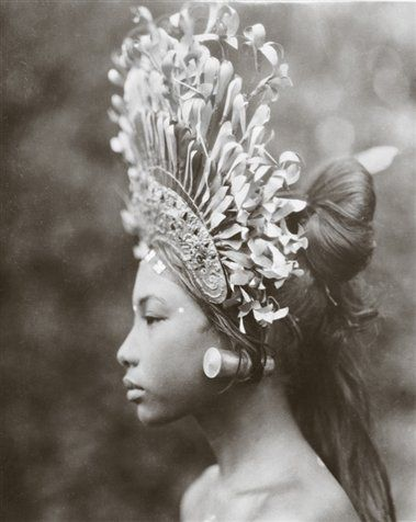 "Absolute Grace & Beauty. Circa 1930's. A towering headdress and plug earrings adorn a 1930s Balinese djanger dancer, part of a coed performance that was ""more of popular fun than of temple dance or disciplined art,"" wrote Maynard Owen Williams in his March 1939 Geographic article, ""Bali and Points East."""