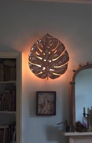 An interesting wall sconce to go with the Monstera Leaf hanging light