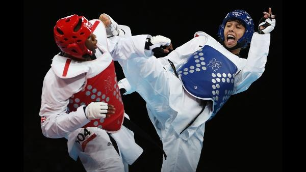 Lutalo Muhammad of Great Britain competes against Farkhod Negmatov of Tajikistan during the Men's -80kg Taekwondo Preliminary Round on Day 14 of the London 2012 Olympic Games at ExCeL on August 10, 2012 in London, England. (Photo by Hannah Johnston/Getty Images)