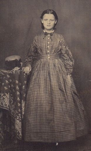 Young lady in simple plaid dress,  buttons in front, bow at neck.Plaid Dresses, Cdv S, 19Th Century, 1860S, Buttons, Bows, Cdvs Children, Young Lady, Simple Plaid