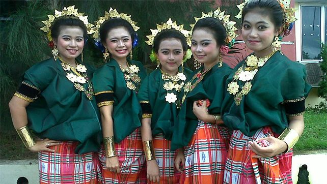 Bugis girls in traditional costume, baju bodo, South Sulawesi,  Indonesia.