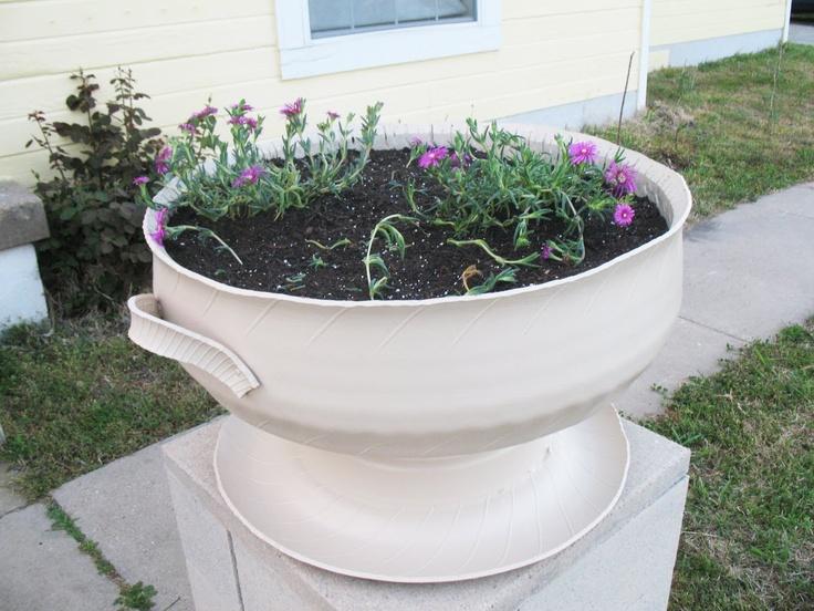 Tire planters with cinder block plinth @ http://shoestringpavilion.blogspot.com/2011/04/tire-planters-with-cinder-block-plinth.html