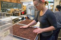 """An artisan chocolate factory started in 2010. There is a tour on which you can taste cacao as it is being processed. They're so into the science behind it, their website has diagrams of """"particle size distribution"""" of beans milled by different machines."""