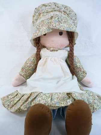 holly hobbie - so I had a bedspread a canopy and multiple dolls i still have one today
