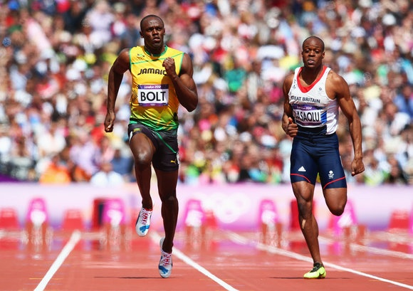 Usain Bolt of Jamaica and James Dasaolu of Great Britain compete in the Men's 100m Round 1 Heats on Day 8 of the London 2012 Olympic Games at Olympic Stadium on August 4, 2012 in London, England. (Photo by Michael Steele/Getty Images)