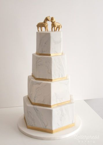 Marble Hexagon wedding cake with gold geometric horse toppers. Carrot cake, four tier grey and white marble with gold trim wedding cake. Vancouver BC