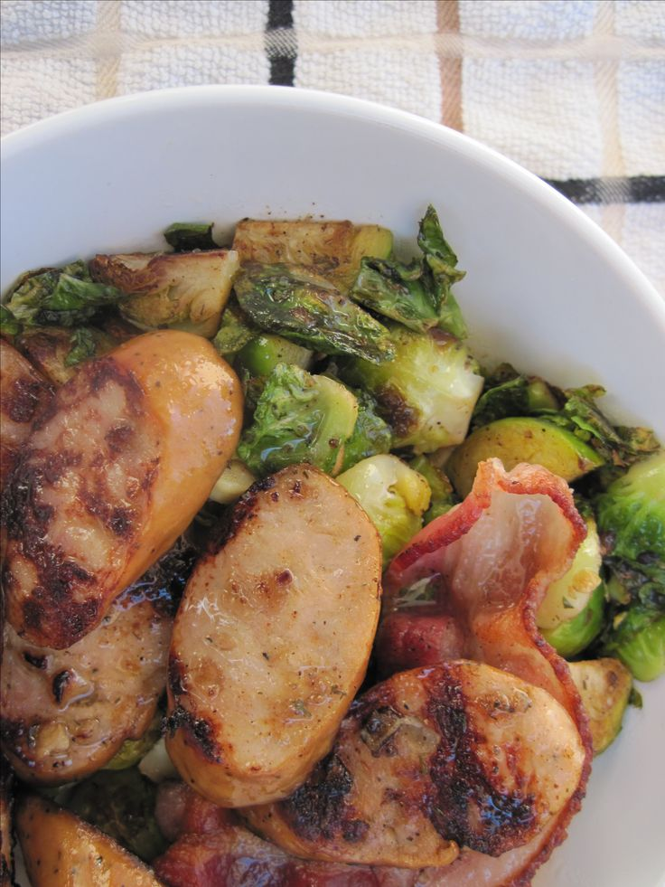 "#paleo ""My New Go-To Meal"": 1 cup brussel sprouts, cut into fourths; 1 Applegate Chicken Apple Sausage, sliced; 1 piece of bacon, cut in half; 1 garlic clove, minced; 4 tablespoons Tessamae's Zesty Ranch; salt and pepper, to taste (Could add an fried egg on top)"