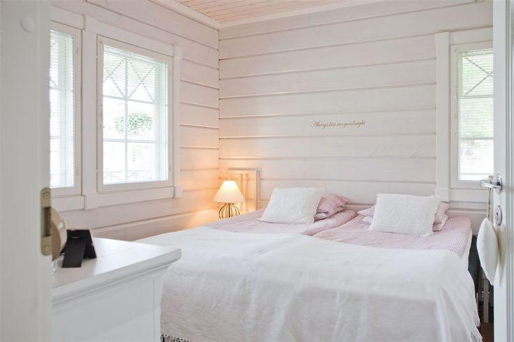 White log house bedroom