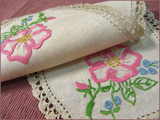 Some might see this item more as a dresser scarf but it is also close to the definition of a doily.  Either way the embroidery is very pretty to look at.