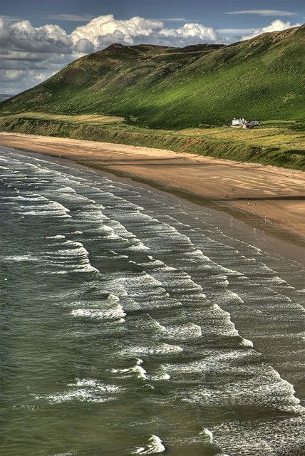 The beach at Rhossili Bay (NT) Gower Peninsula, South Wales