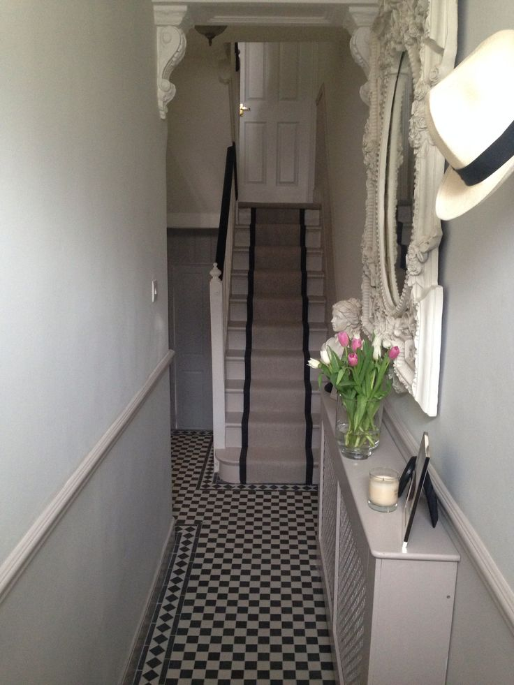 Love my hallway! Black and white tiles, herringbone stair runner, elephants breath and strong white walls