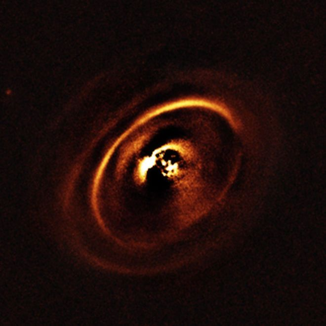 Swirls of Planet Birth Revealed with ESO's Very Large Telescope (Photos)