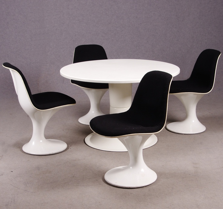 "Dining Group, consisting of the chairs ""Orbit"", Mark Farner  Walter Grounds for Herman Miller, in white fiberglass and fabric upholstered seat. Dining table: ""Saturn"", Yrjö Kukkapuro for Haimi, designed in 1966."