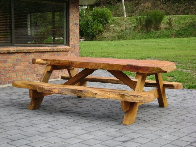 Picnic table with an inspirational and natural design. Made from Macrocarpa Wood and beautifully handcrafted in New Zealand - Picnic Setting 2m $1280 2.4m $1480 - http://www.macsmacrocarpa.co.nz/page10.html