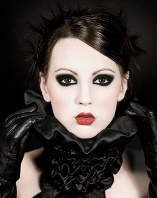 Neo-Victorian makeup in neo-Victorian gothic colors.