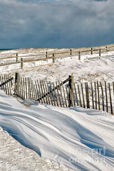 Drifting snow along the beach fences at Nauset Beach in Orleans on Cape Cod, Massachusetts 2 days after some 3 feet of snow and hurricane force winds hit the Cape during the Blizzard of '05 in January of 2005.