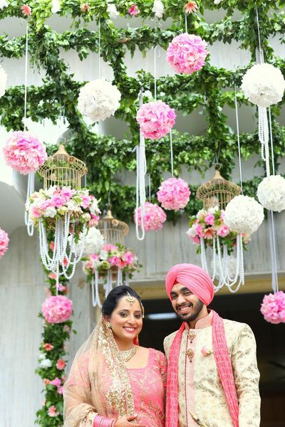 Floral balls , white and pink floral hanging, birdcages with pearls , hanging pearls
