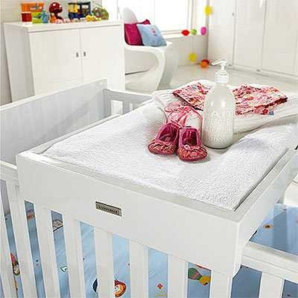 Brilliant idea! a portable changing table you can put on top of a crib!