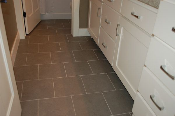 How to install heated tile floor flooring ideas laundry for Laundry room floor ideas