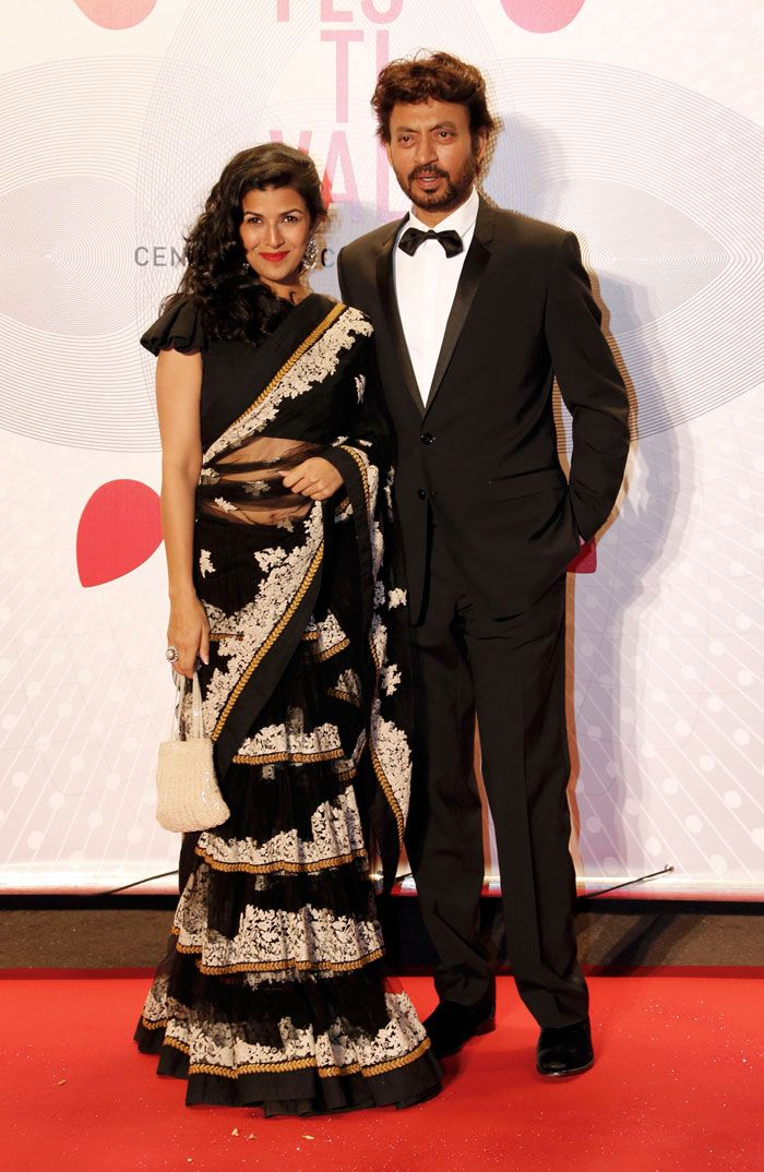 Irrfan Khan with co-star Nimrit Kaur, who was also seen in a black Sabyasachi lehenga sari at the evening's gala of Bombay Talkies celebrating 100 years of Indian cinema, during the 66th Cannes Film Festival. (Reuters)