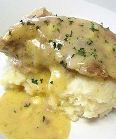 Recipe for Ranch House Crock Pot Pork Chops with Parmesan Mashed Potatoes - The ranch dressing in the gravy and the Parmesan and garlic in the potatoes complemented each other well. Delicious!