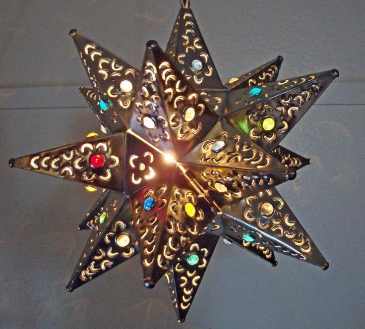 Mexican tin stars are a unique take on lighting and make beautiful hanging decor http://puertabella.blogspot.com/2010/04/mexican-fiesta-favorites.html