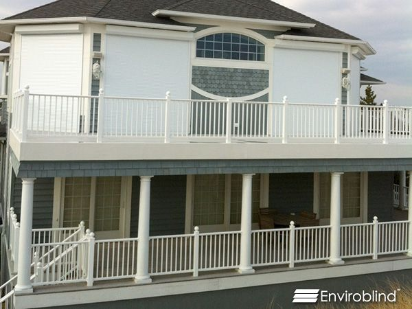 Blue two stroy house with Enviroblind Rolling Security Shutters