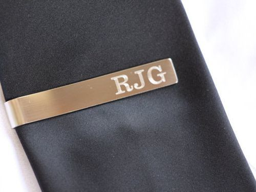 All the Guys Will Never Reach Down and Have Their Tie Fall Out Again! The Perfect Gift for Your Groom, Groomsmen, Father of the Bride and Groom, Grandparents, Ushers, and More, Our Personalized Stainless Steel Tie Clip Can be Custom Engraved with a Name, Monogram, or Initials! This Brushed Stainless Steel Tie Clip is a Unique Personalized Gift That Can be Given for any Special Occasion!  Makes a Great Father's Day or Birthday Gift for Him! Included with Each Tie Bar is a Gift Box, Perfect…
