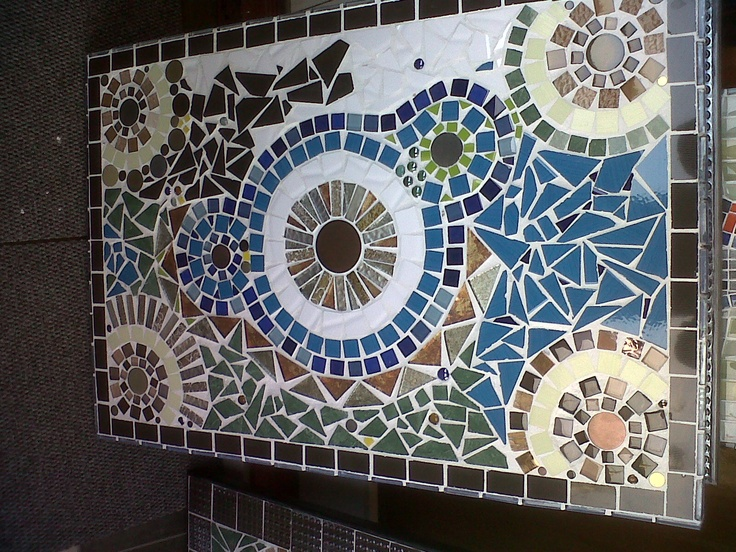 Unique mosaic coffee table in glass mosaic and ceramics